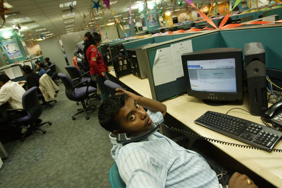 An employee of Convergys Corp., a global leader in call-center outsourcing, speaks with a client in a suburb of New Delhi.